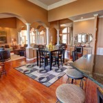 dining and living areas with arches