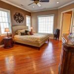 master bedroom with hardwood floor